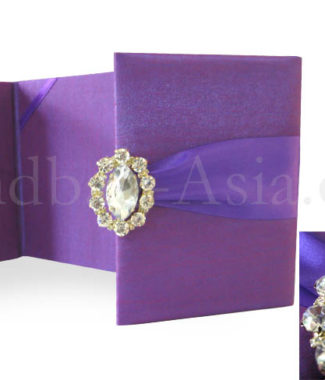 Purple wedding invitation folder with brooch