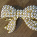 Golden pearl bow embellishment