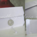 white wedding envelope with brooch and pocket holder