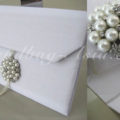 Luxury white wedding envelope with pearl brooch