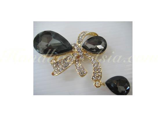 Golden bow embellishment