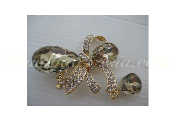 gold plated crystal bow brooch