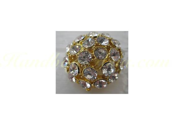 golden crystal brooch
