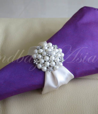 silk napkin with pearl brooch napkin holder