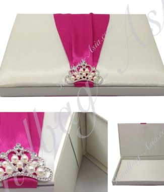 ivory wedding box with fuchsia ribbon and pearl crown brooch