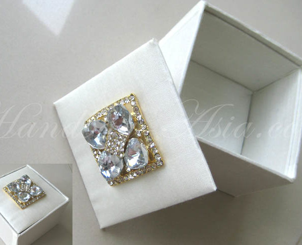 ivory silk gift box with golden brooch