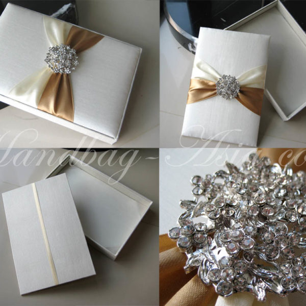 ivory silk invitation box with brooch