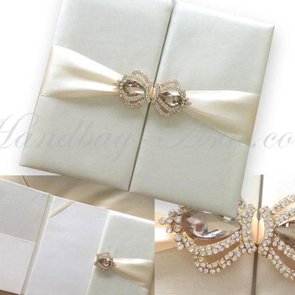 ivory custom invitation with crown brooch