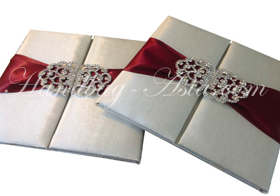 ivory silk folio with red ribbon and clasp