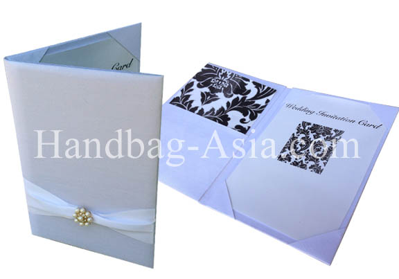 white silk pocket fold with pearl brooch for invitation cards