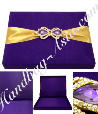 Purple wedding box with crown brooches
