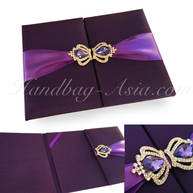 Eggplant color silk wedding folder with crown brooches and purple ...