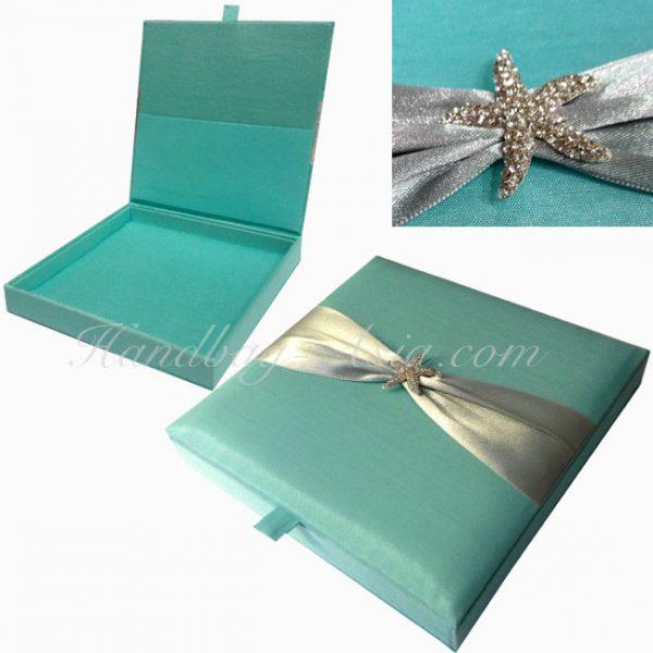 beach theme boxed wedding invitation with starfish rhinestone brooch