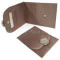 bronze wedding envelope with pearl brooch