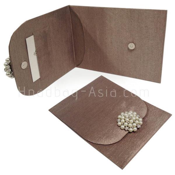 bronze wedding envelope with pearl brooch