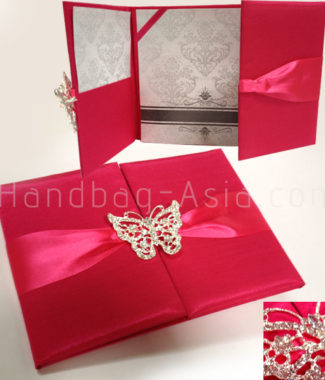 deep pink wedding pocket folder with butterfly brooch