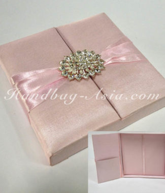 soft pink wedding box with brooch
