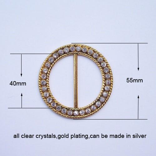 round golden crystal buckle