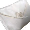 ivory silk envelope with pearl