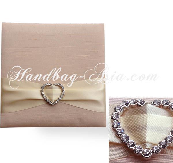 heart brooch embellished wedding invitation