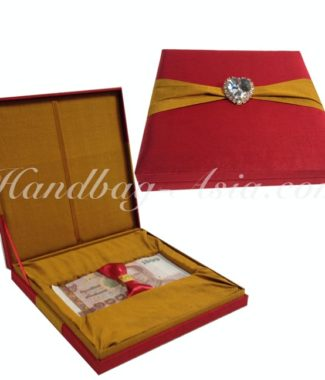 red and gold silk gift box for bank notes
