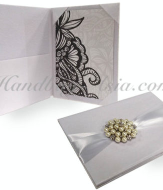 white silk wedding folder with pearl brooch