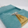 velvet wedding box with pearl crown brooch embellishment