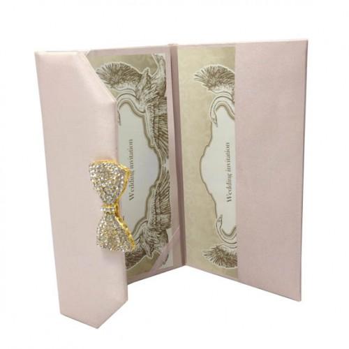 Luxury blush pink wedding envelope with brooch