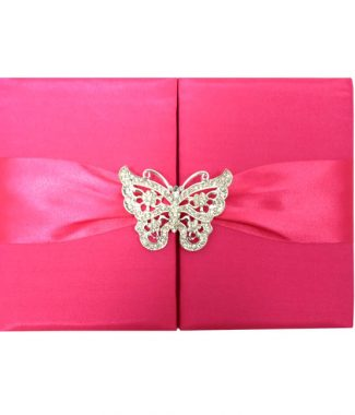 Fuchsia wedding invitation with butterfly brooch