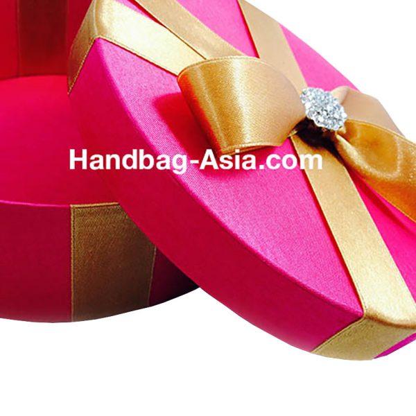 luxury round silk wedding box with rhinestone brooch