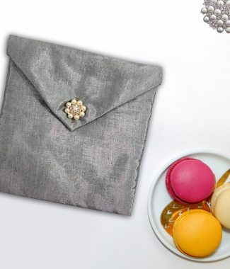silk envelope with pearl button closure
