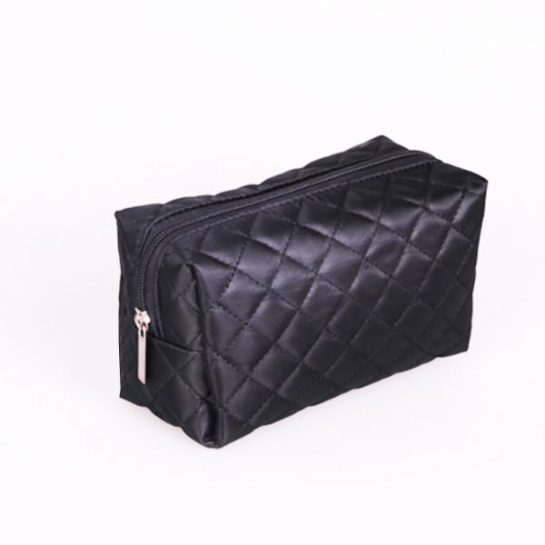 Black quilted satin cosmetic bag