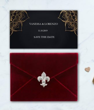 red velvet envelope with brooch