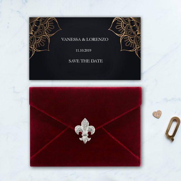 red velvet envelope with brooch