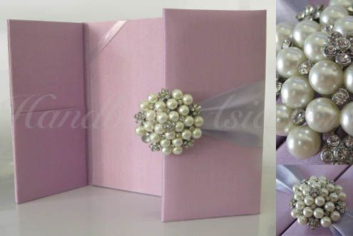Blush pink pearl brooch embellished couture silk folder for wedding invitations