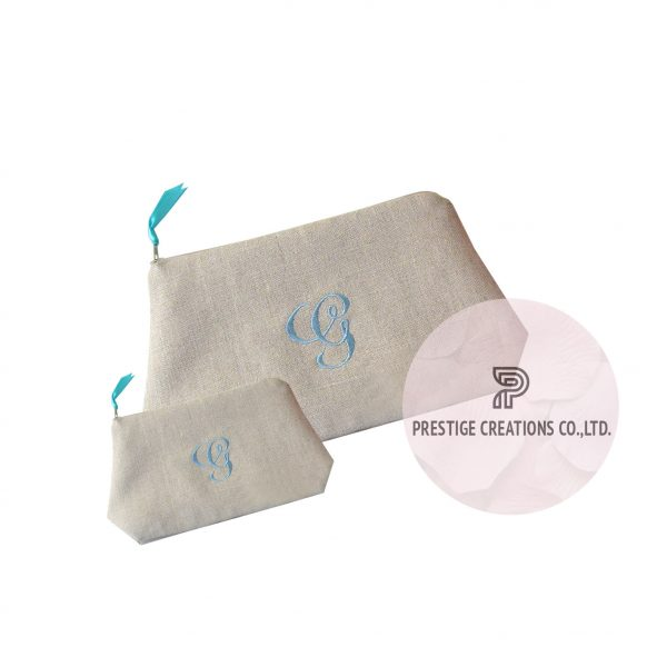 Monogram embroidered cosmetic bags