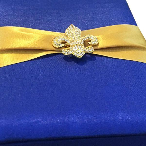 golden fleur de lis brooch