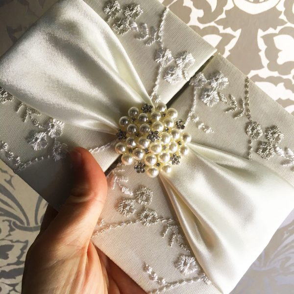 luxury lace invitations with pearl brooch