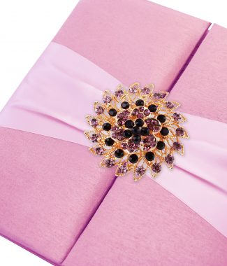 pink brooch embellished silk folder