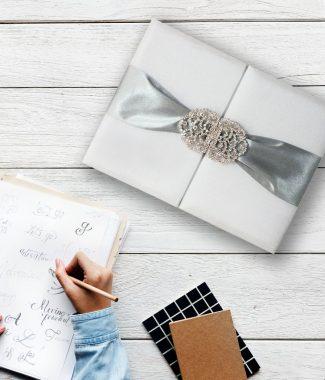 white and silver wedding invitation folder