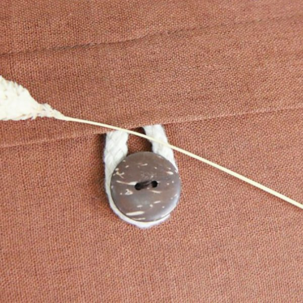 linen cushion with button closure