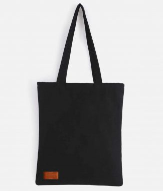 Black canvas tote bag with leather badge
