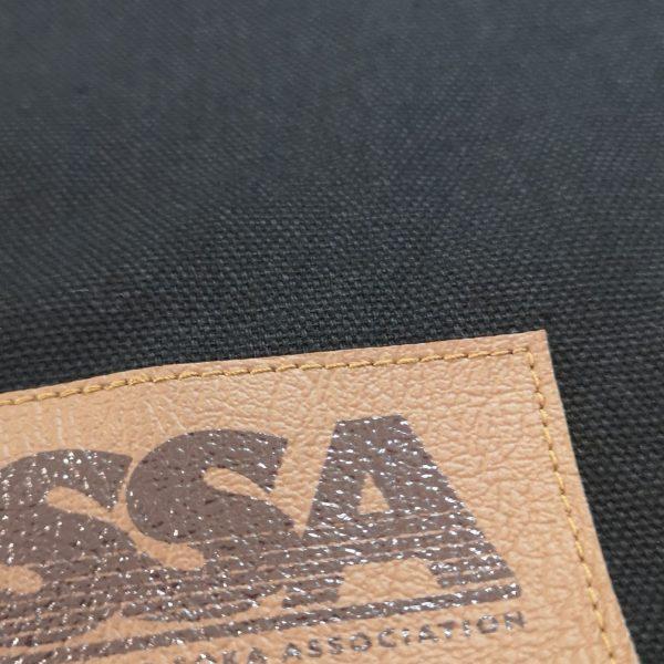 detail of leather bagde