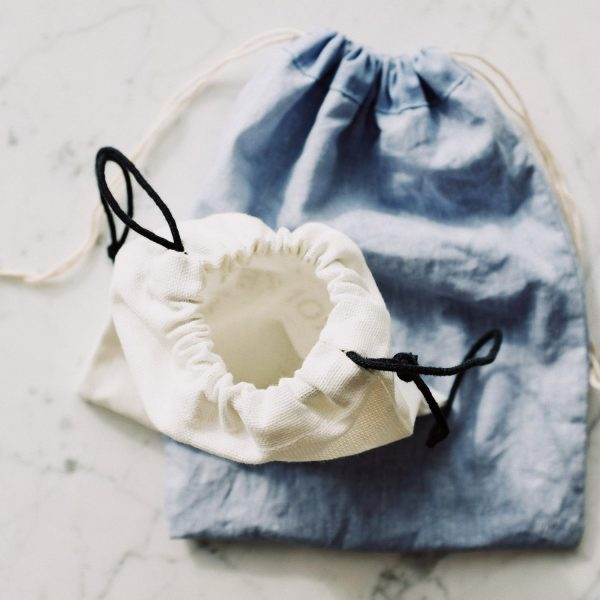 off-white and blue linen bags with drawstring closure